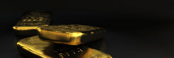 physical gold bullions ingots, golden bars over black background with room for text